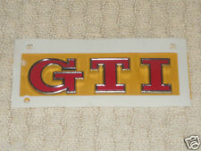 NEW GENUINE VW GOLF GTI REAR TAILGATE GTI EMBLEM IN RED 5G0853675AC JZQ