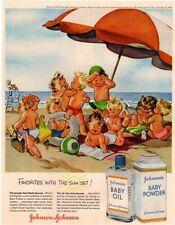 1956 JOHNSON'S Baby Oil - Cute Babies Sunbathing On Beach Cartoon  VINTAGE AD