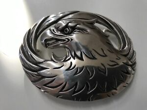 Solid , sculpted eagle with wings men's belt buckle.polished silver plaiting.