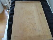 Child size bread/noodle board. Baker's ends/hole to hang.