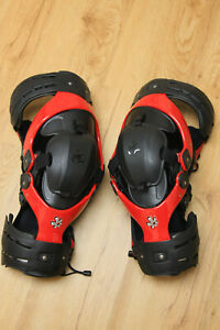 NWOT PAIR Asterisk Ultra Cell knee braces Red and black.