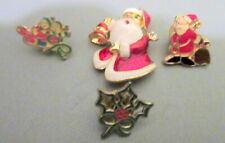 GROUP OF FOUR CHRISTMAS BADGES AND BROOCH