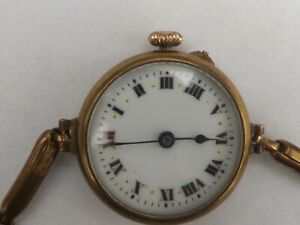 a fine antique gold plated trench watch