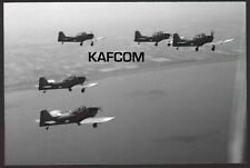 5 Fokker S11 Instructor Aeroplanes in Flight. 7 inch x 4.75 inch Photograph