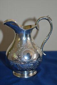 Vintage silver-plated creamer / milk jug engraved with floral design.
