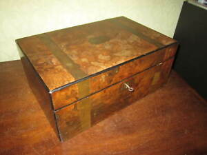 An old Victorian brass bound walnut writing slope with working lock and key