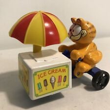 "Vintage Garfield w/ Ice Cream Cart Made by Ertl  3"" long"