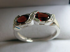 925 Sterling silver ring with diamond and garnets