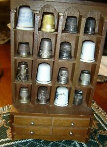 Collection of  16 thimbles in wooden case most very old.