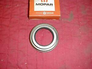 NOS MOPAR 1957-65 REAR AXLE PINION SEAL W/ 8 3/4 REARS
