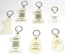 Lot mit 7 Porte-clés USA porte-clé années 1970 Lumières dans le sombre - Numéro