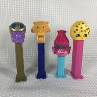 LOT OF 4 MARVEL'S THANOS PEZ POPPY SHOPKINS ICE AGE COOKIE DIEGO TROLLS EUC FS