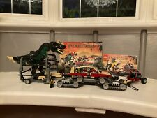 Lego dinosaur hunter, cat vehicle, trailer, buggy and dinosaur.