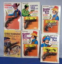 Cap Guns ~ Set of 6 Old Die Cast Cap Gun Key Chain Fobs on Store Display Cards