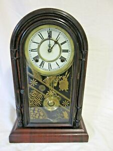 A Late 19th Century Rosewood Mantel Clock By Waterbury