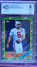 1986 Topps Steve Young Rookie Card #374 BCCG 8, PSA Competitor.