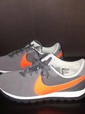 Nike Women's US Size 6.5 orange Swoosh