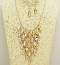 Gold and Clear Dangling Charms Necklace Set