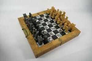 Vintage oriental theme handmade folding, wooden chess set. Japanese figures
