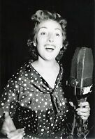 A 12 x 8 inch photo personally signed by Singer Dame Vera Lynn.