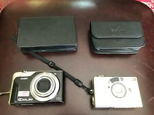 Four Digital Cameras and 2 Camera Case