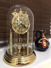 vintage/brass antique anniversary torsion clock,glass dome mantel/carriage