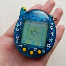 Tamagotchi 2004 BANDAI CLEAR SEE THROUGH Sea Blue with Letters Around The Edge