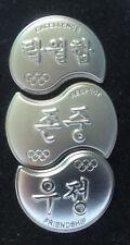 PYEONGCHANG 2018 OLYMPIC GAMES. 3 SMALL IOC PINS MAKING A PUZZLE.