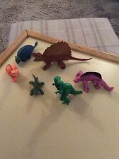SIX ASSORTED DINOSAURS IN SHAPES, SIZES AND COLOURS