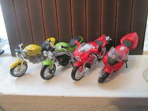 4 MAISTO 1-18 SCALE MOTORCYCLE MODELS TRIUMPH DUCATI HONDA