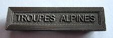 Agrafe barrette TROUPES ALPINES pour rubans de médailles militaires.