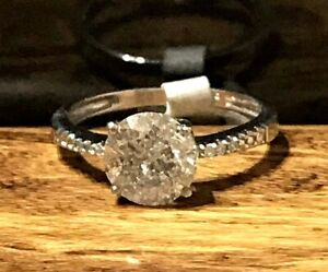 1.87 Ct Diamond solitaire/engagement with diamond shoulders.