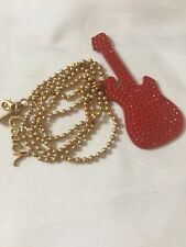 COACH RED PAVE POP GUITAR PENDANT WITH GOLD TONE CHAIN NECKLACE AND COACH LOGO