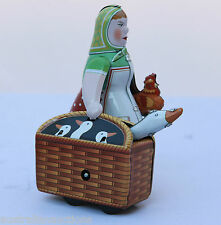 TIN TOY WOMAN WITH GOOSE MECHANICAL WIND UP  COLOURFUL & FUN COLLECTIBLE