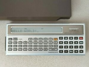 Vintage Sharp PC-1212 Pocket Computer with box. Made in Japan.