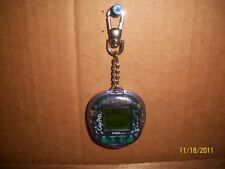GIGA PETS, MICROCHIMP, KEYCHAIN GAME, WATCH/ALARM, TIGER, 1997, COLLECTIBLE, TOY