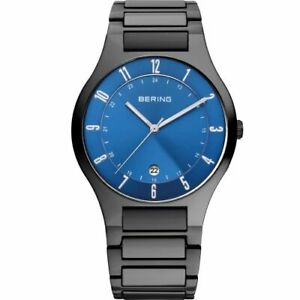 Bering Time - Mens Black Titanium Watch with Blue Dial 11739-727