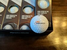 Box of TaylorMade Tpx5x Golf Balls and OnlyInboards.com T-Shirt