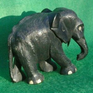 A detailed study of a walking African elephant carved in Ebony hardwood