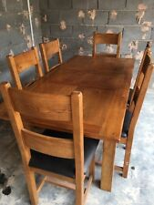 Solid oak extending dining table seats 6