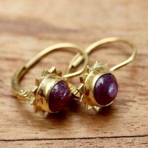 Ruby Rapture Earrings: Museum of Jewelry