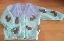 HAND KNITTED BABY RABBITS CARDIGAN. AGE 3-6M.  FIRST XMAS GIFT IDEA?