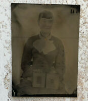 Antique Photo, Victorian Tintype of a woman holding a photo album