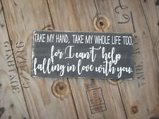 For I can't help falling in love with you on a wood sign.  Elvis lyrics