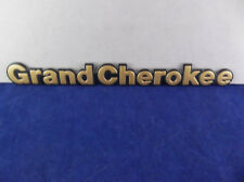 "1993-1998 Jeep ""Grand Cherokee"" Gold Letter Side Emblem OEM"