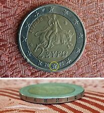 "2 EURO 2002 COIN WITH( ""S"" ERROR INSIDE STAR BETWEEN 20 AND 02)"