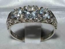 Aquamarine Anniversary Round Three-Stone Fine Rings