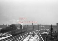 PHOTO  2 CAR SUBURBAN AS ECS PASSING MOTHERWELL SHED. SOME STEAM LOCOMOTIVES VIS