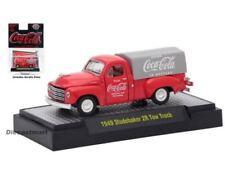 Voitures, camions et fourgons miniatures rouges coca-cola