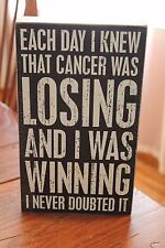 "Primitives by Kathy Wooden Box Sign ""Each Day I knew Cancer Was Losing..."""